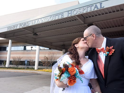 Bride Crysta Danaher and groom William Anderson kiss