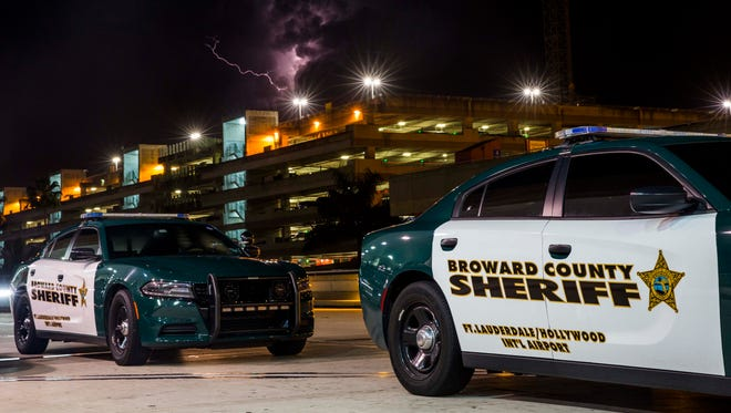 Broward County Sheriff vehicles park outside of Terminal 2 at the Fort Lauderdale - Hollywood International Airport. A gunman opened fire in the baggage claim area at the airport Jan. 6, killing five people and wounding at least six others before being taken into custody.