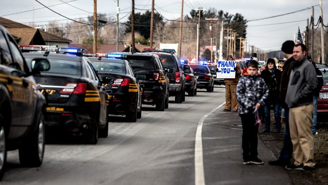 Funeral services were held Saturday for Officer Thomas Cottrell Jr. of Danville who was killed in the line of duty last week. Hundreds of police officers attended the service at OSU Newark, and escorted the fallen officer with police lights flashing to Wilson Cemetery.