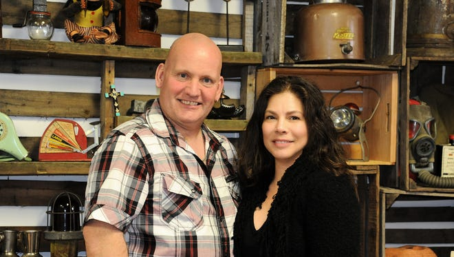 Gallery on Main owners Shaun Daley of Somerset and Michelle Pankowski Mundt of Hillsborough amid just a few of the vintage finds they have for sale in their new Somerville shop. Gallery on Main will celebrate a grand opening on June 11.