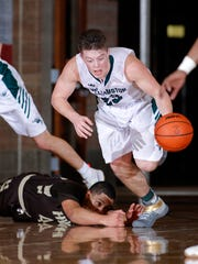 Williamston's Cole Kleiver gets a steal against Holt's