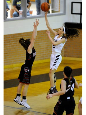Bowie's Kamryn Cantwell (5) puts up a shot over Colorado City's Clancy White (3) during the second quarter of Bowie's 54-43 win in the Region I-3A quarterfinal playoff on Tuesday, Feb. 21, 2017, in Cisco.