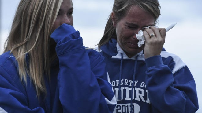 Dawn and Alysa Gaes, Taylor Gaes' mother and sister, react while Taylor's father speaks to the crowd during a vigil for Taylor Wednesday, June 10, 2015 at the Colorado State University Equine Center in Fort Collins, CO.