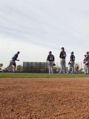 The Brewers practice drills  at Maryvale Baseball Park in Phoenix.