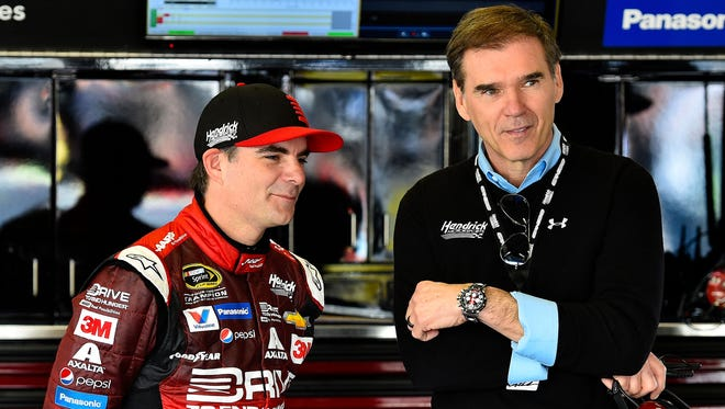 Feb 21, 2015: NASCAR Sprint Cup Series driver Jeff Gordon (24) talks to with his former crew chief Ray Evernham during practice for the Daytona 500 at Daytona International Speedway.