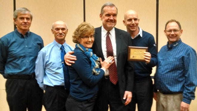 "Joel Fleischman and longstanding team members of Drexel's Building Supply, accepted the ""2015 WRLA Dealer of the Year"" award at the Wisconsin Lumber Dealers Convention held in January. From left: Ron Neitzel, residential estimator; Duane Schliepp, receiving/operations; Judy Ehlenbeck, accounts payable; Larry McCarren of the Packers Radio Network; Joel Fleischman, CEO/solution provider ; and Rob Dean, window specialist."