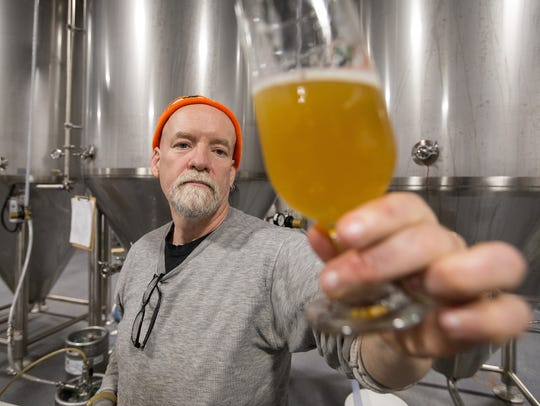 Tim Eichinger started brewing Black Husky beers in the woods of Pembine before opening a brewery and taproom in Milwaukee. Black Husky will host the beer gardens in Washington County staring in May.