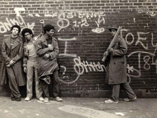 Dozens of photographs such as this are featured in a Wall Writers book. Pioneers of the street art will be at the MAG in Rochester on Nov. 11.
