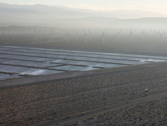 The groundwater recharge ponds in the desert next to Palm Springs were often largely empty during California's five-year drought. This year the ponds have been filled with a record amount of imported water.