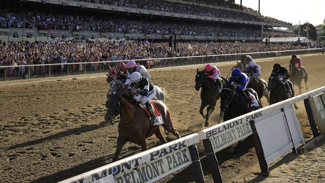 Sir Winston (7), with jockey Joel Rosario up, crosses the finish line to win the 151st running of the Belmont Stakes on June 8, 2019. AP Photo/Seth Wenig