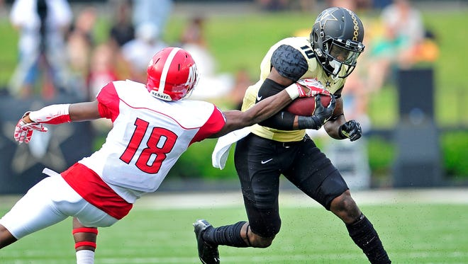 Austin Peay defensive back Damien Whitfield (18) tries to strip the ball from Vanderbilt wide receiver Trent Sherfield during the second quarter on Saturday, Sept. 19, 2015.