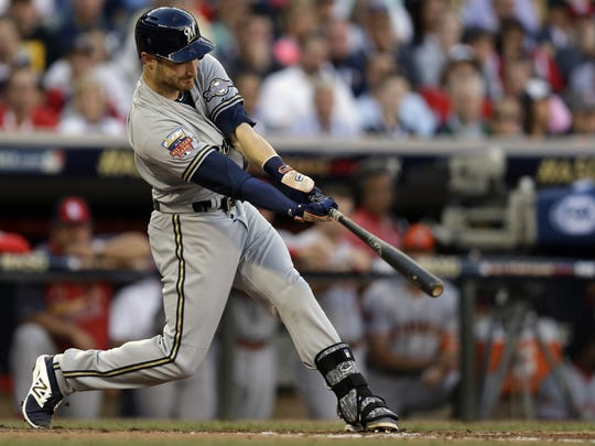 Jonathan Lucroy of the Milwaukee Brewers hits an RBI double during the second inning of the MLB All-Star baseball game, Tuesday, July 15, 2014, in Minneapolis.