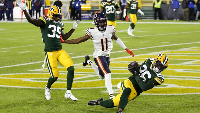 Green Bay Packers' Darnell Savage intercepts a pass in the end zone in front of Chicago Bears' Darnell Mooney during the first half Sunday in Green Bay, Wis.