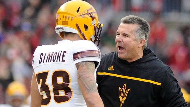 Nov. 7, 2015; Pullman, Wash.; Arizona State coach Todd Graham talks with defensive back Jordan Simone during a game against the Washington State Cougars at Martin Stadium.