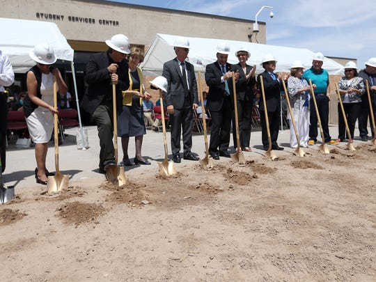 Dignitaries from El Paso Community College and Texas Tech University ceremoniously break ground on a new building that will house the architecture program Thursday at EPCC's Valle Verde Campus. The 19,606-square-foot building will be built at a cost of $4,041,900. It is scheduled for completion in February. Students enrolled in the architecture program can receive an associate's degree from EPCC and move on to Texas Tech University's upper-level program in the same building.