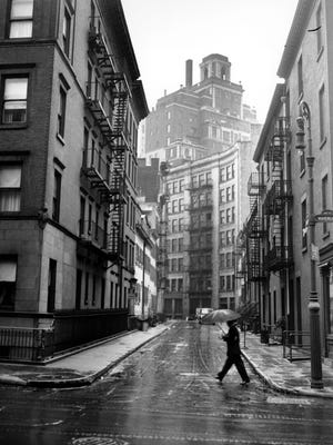 A man crosses the street at the corner of Gay Street and Waverly Place in Greenwich Village in New York City on Nov. 15, 1945.