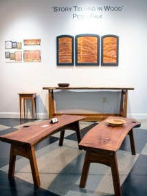 """""""Story Telling in Wood"""" at ArtSplash Gallery in Carmel is celebrating the work of Indiana woodworker Peter Falk, who made the two shorter benches, the long table against the wall and the triptych on the wall."""