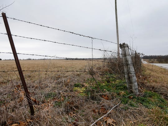 This section of barbed wire was cut by Howard Perryman