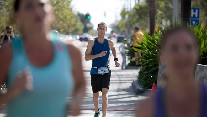 Matt Treat of Milwaukee, Wisconsin was the first runner to cross the finish line during the Marathon of the Treasure Coast in Stuart March 5, 2017. Treat finished with a time of 2:28:22.5.