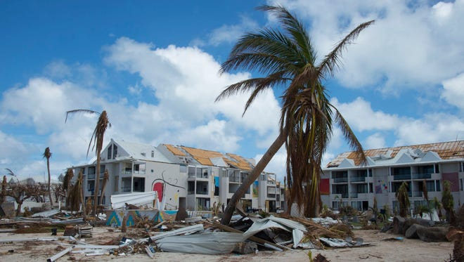 A picture taken in Nettle Beach bay on the French Caribbean island of Saint Martin on Sept. 16, 2017 shows the damaged Mercure hotel after the island was hit by Hurricane Irma.