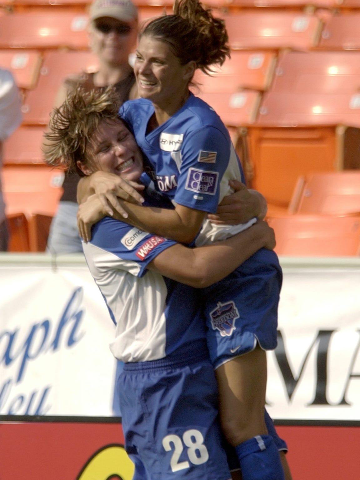 The Washington Freedom's Mia Hamm, right, celebrates a goal with teammate Abby Wambach against the Atlanta Beat at RFK Stadium on Aug. 4, 2002.
