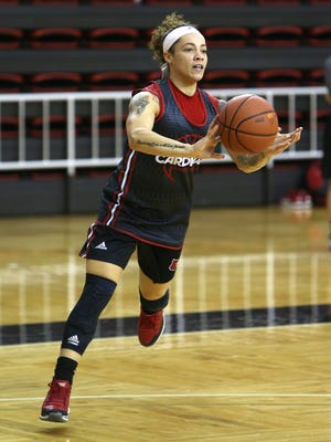 UofL guard Briahanna Jackson passes off during practice.October 27, 2015
