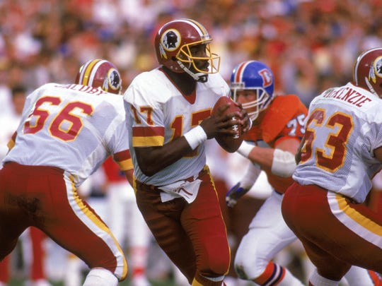 Doug Williams drops back to pass in the Super Bowl against the Broncos on Jan. 31, 1988.