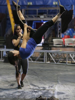 Yasmin Rivera with Circus Vargas works on a new move while Anabel Bachliysq watches as they prepare Thursday November 27, 2014 for the upcoming week of shows in Cathedral City.