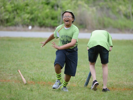 Eric Springfield, 11, runs haphazardly after finishing a round of Dizzy Bat during field day Thursday at East Elementary School.
