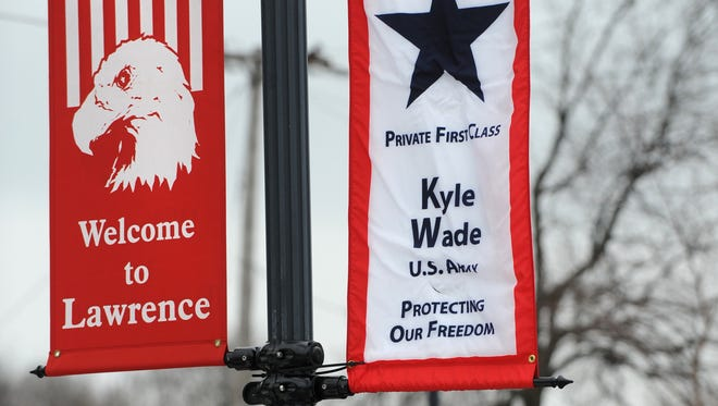 A banner hangs at the Lawrence Government Center honoring Army Pfc. Kyle Wade on March 1, 2010. The program was started to honor those local military personnel who are deployed and serving their country.