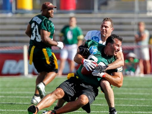 When Brett Favre Takes Field Sunday His >> Seattle Seahawks linebacker Chad Brown, behind, takes