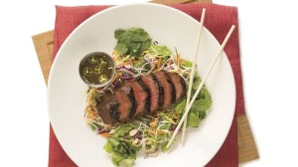 Rice Noodle Salad with Ginger-Soy Top Sirloin includes napa slaw, basil, mint, snow peas, cilantro, scallions, roasted peanuts and chili-lime dressing at 590 calories.