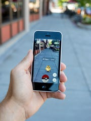 "A Pokemon is seen on the sidewalk on Military Street in the popular augmented reality game ""Pokemon Go."""
