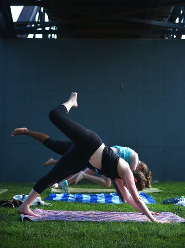 Haley O'Neill participates in Yoga on the Water at
