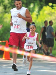 A family of runners competes in the Jungle Jog 5K 2013.