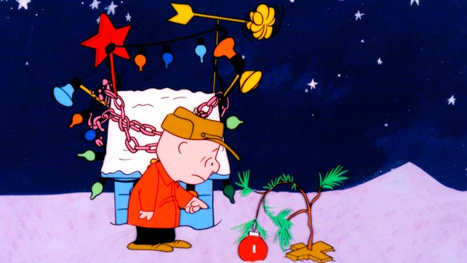 Charlie Brown is disappointed  about the overwhelming materialism he sees among everyone during the Christmas season and tries to share the holiday with a special tree in 'A Charlie Brown Christmas.'