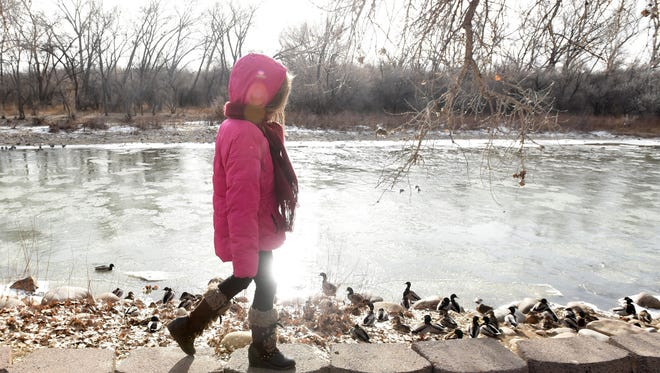 McKenna Villers, 8, walks along the Animas River in Farmington on Dec. 19. The San Juan Water Commission is coming up with a plan for allocation of local water resources.