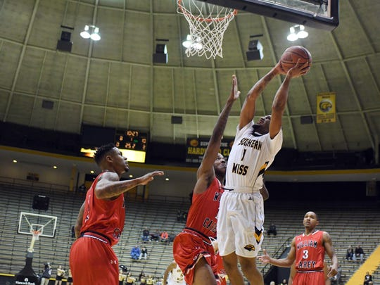 Southern Miss'  Cortez Edwards shoots for the basket in a game against William Carey in Reed Green Coliseum on Saturday.