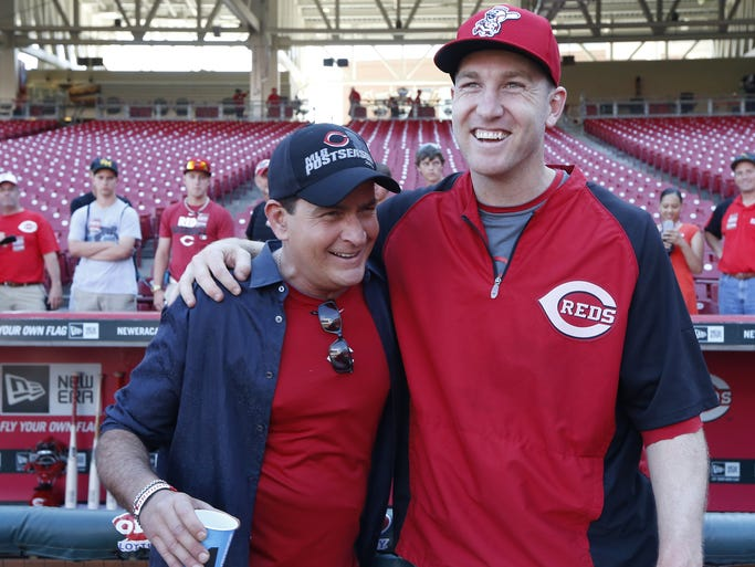 Actor Charlie Sheen and guest analyst on ESPN's Baseball Tonight took time during batting practice to meet Reds Todd Frazier at Great American Ball Park prior to their game against the St. Louis Cardinals.