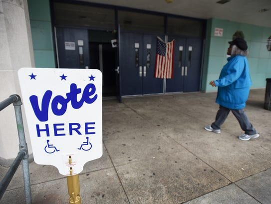 A woman goes into the polling station at the Hackensack