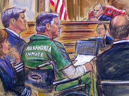 This March 7, 2019, courtroom sketch depicts former Trump campaign chairman Paul Manafort, center in a wheelchair, during his sentencing hearing in federal court before judge T.S. Ellis III in Alexandria, Va. Manafort was sentenced to nearly four years in prison for tax and bank fraud related to his work advising Ukrainian politicians, a significant break from sentencing guidelines that called for a 20-year prison term. (Dana Verkouteren via AP)