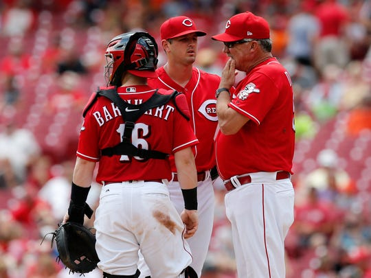 Cincinnati Reds pitching coach Danny Darwin visits starting pitcher Tyler Mahle (30) at the mound in the fifth inning of the MLB interleague game between the Cincinnati Reds and the Detroit Tigers at Great American Ball Park in downtown Cincinnati on Wednesday, June 20, 2018. The Reds trailed 2-0 after six innings.