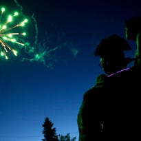 Jerika Bolen and her mother Jen are illuminated by green fireworks Saturday, July 2, 2016 in Menominee, Mich. Danny Damiani/USA TODAY NETWORK-Wisconsin