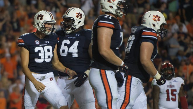 Auburn offensive lineman Mike Horton (64) celebrates with Auburn place kicker Daniel Carlson (38) after he scored a touchdown during the first half of the NCAA football game Saturday, Sept. 10, 2016, at Jordan Hare Stadium in Auburn, Ala. Albert Cesare / Advertiser