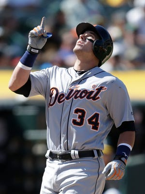 Detroit Tigers' James McCann celebrates after hitting a two-run home run off Oakland Athletics' Ryan Dull in the sixth inning Sunday, May 7, 2017 in Oakland, Calif.
