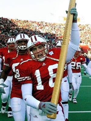 Wisconsin's Jim Leonhard holds up Paul Bunyan's Axe after the Badgers beat Minnesota, 49-31, in Madison in 2002.