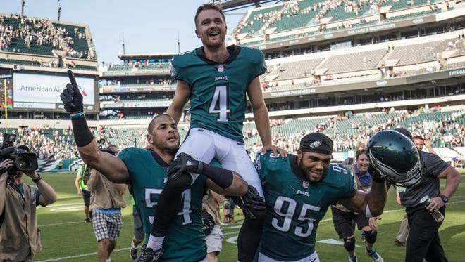 Eagles kicker Jake Elliott is carried off the field after kicking a 61-yard field goal to beat the New York Giants 27-24.
