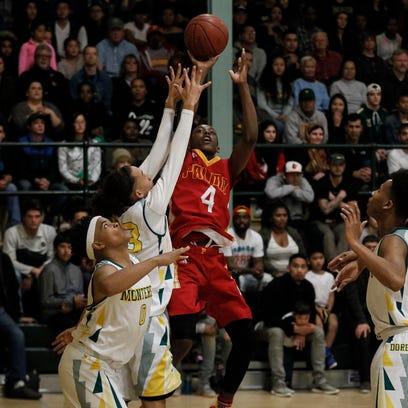 Palma's Jamaree Bouyea shoots the ball over Monterey's