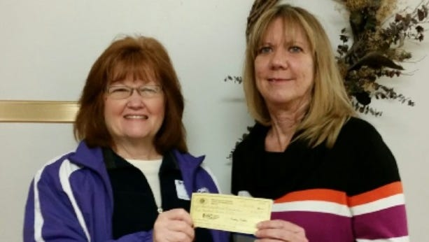 Pecan Valley Kiwanis Club president Deborah Price (left) presents a donation to Cindee Goodwin (right), from Early Childhood Intervention.
