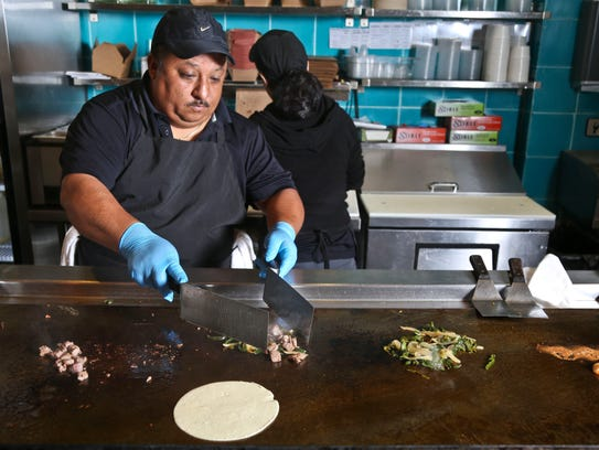 The cooks at Mexa Steak Tacos cook each taco to order.